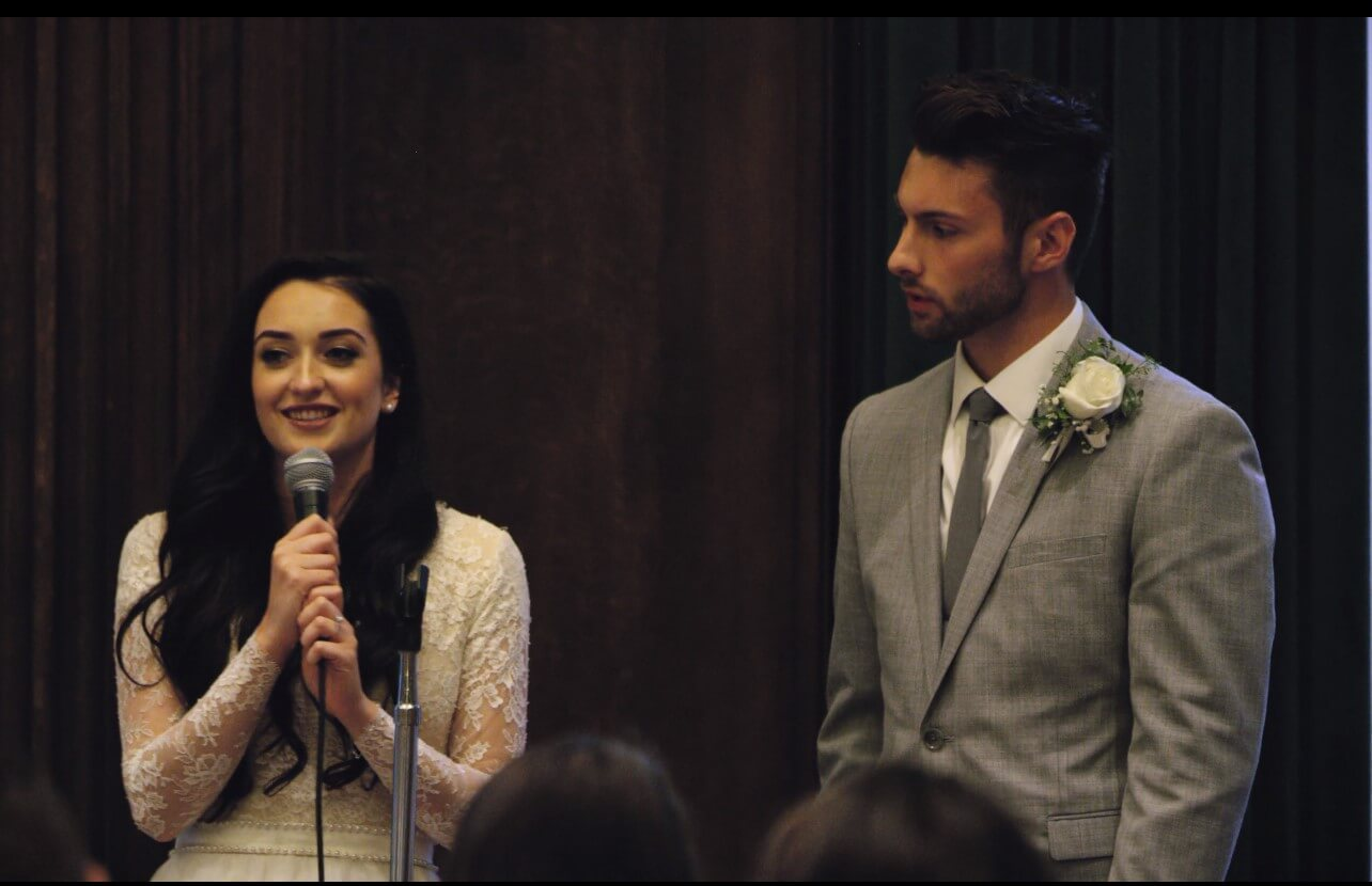 When choosing your wedding video music, consider the setting. Here are the bride and groom during a toast.